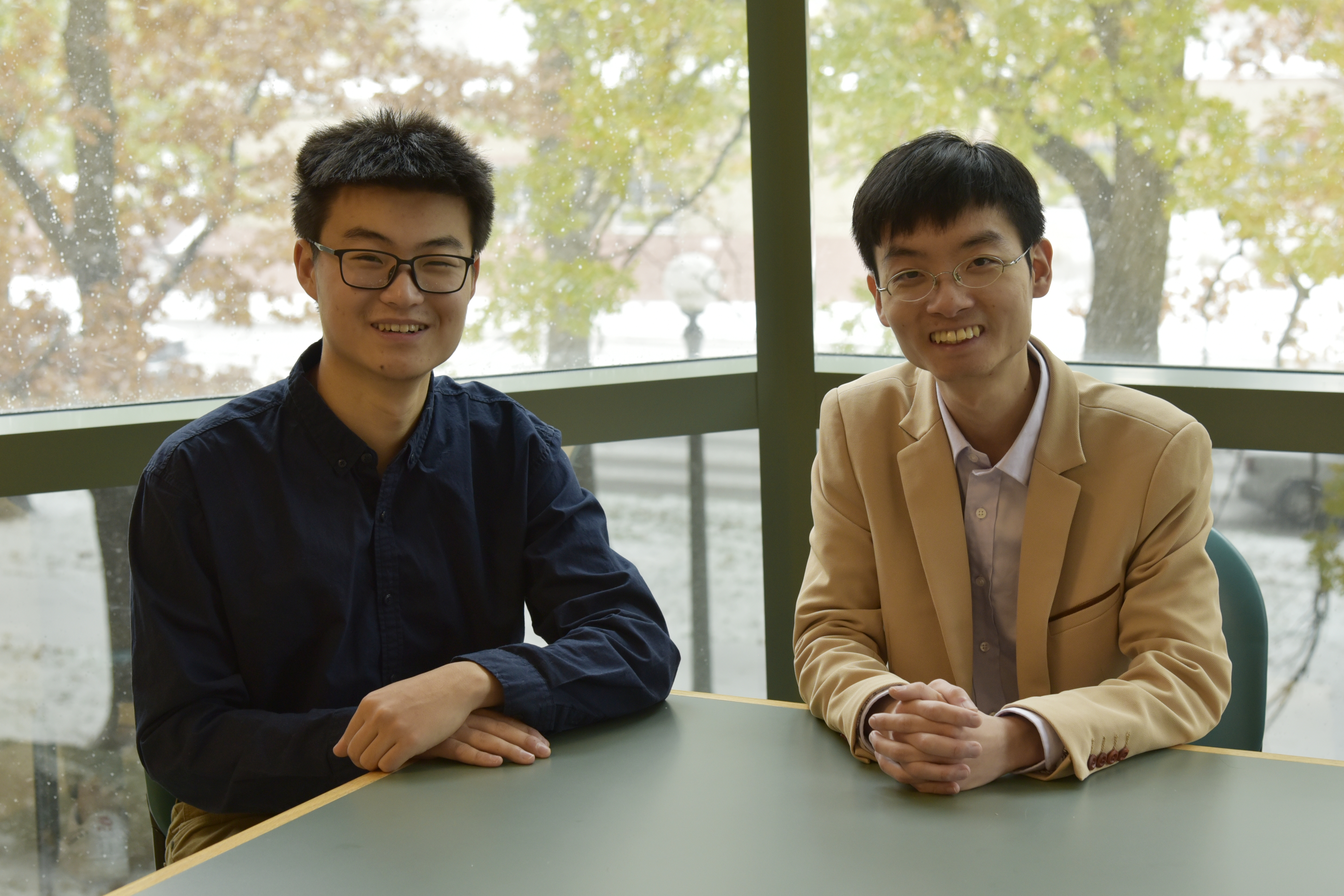 Moore Group members Yuan Jia (left), an undergraduate in chemistry, and Yun Liu, a postdoctoral researcher