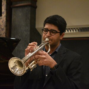 An image of Philip Kocheril playing a trumpet