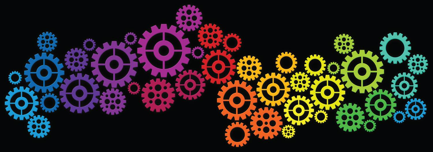 Multi-colored gears on black background