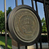 University of Illinois Learning & Labor seal on the gate in front of the Beckman Institute